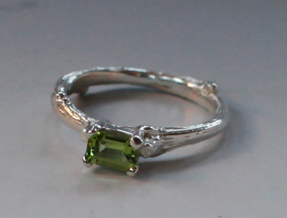 Peridot twig solitaire ring